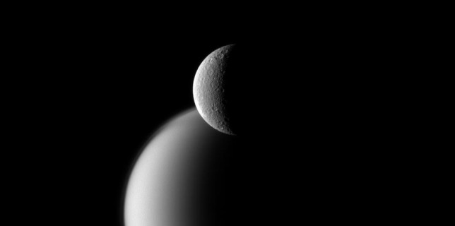Cassini spacecraft view of Rhea and Titan (NASA)