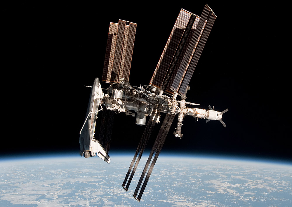 Space Shuttle and Space Station Photographed Together (NASA)